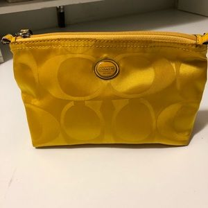 Coach Mustard color Makeup.this is a bag gift bag